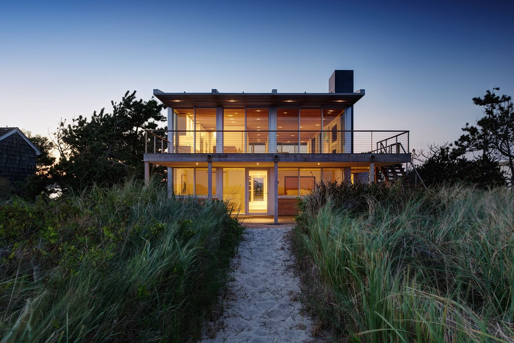 Water Mill, NY Seaside modern residence at dusk