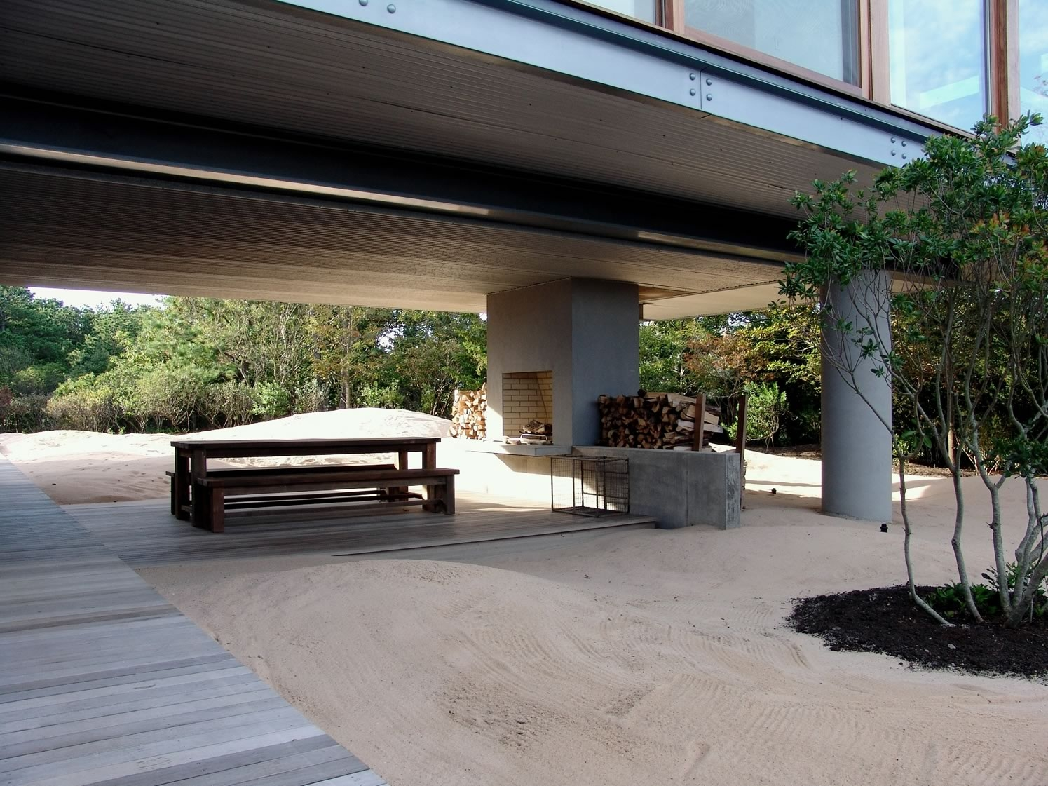 Amagansett, NY Modern Bay Residence Outdoor Fireplace and Dining Area